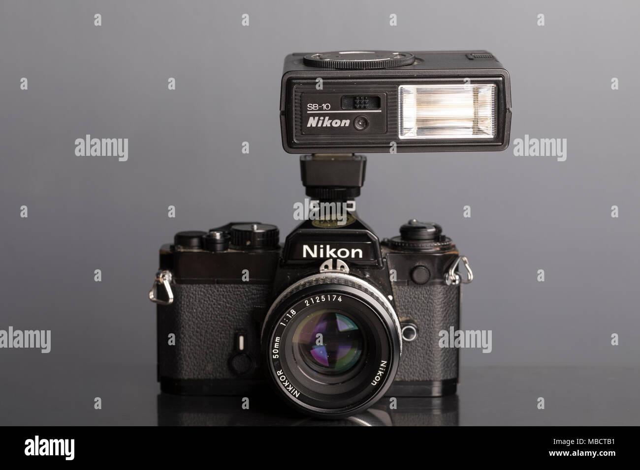 Nikon FE 35mm SLR single lens reflex film camera with SB-10 Speedlight flash - Stock Image