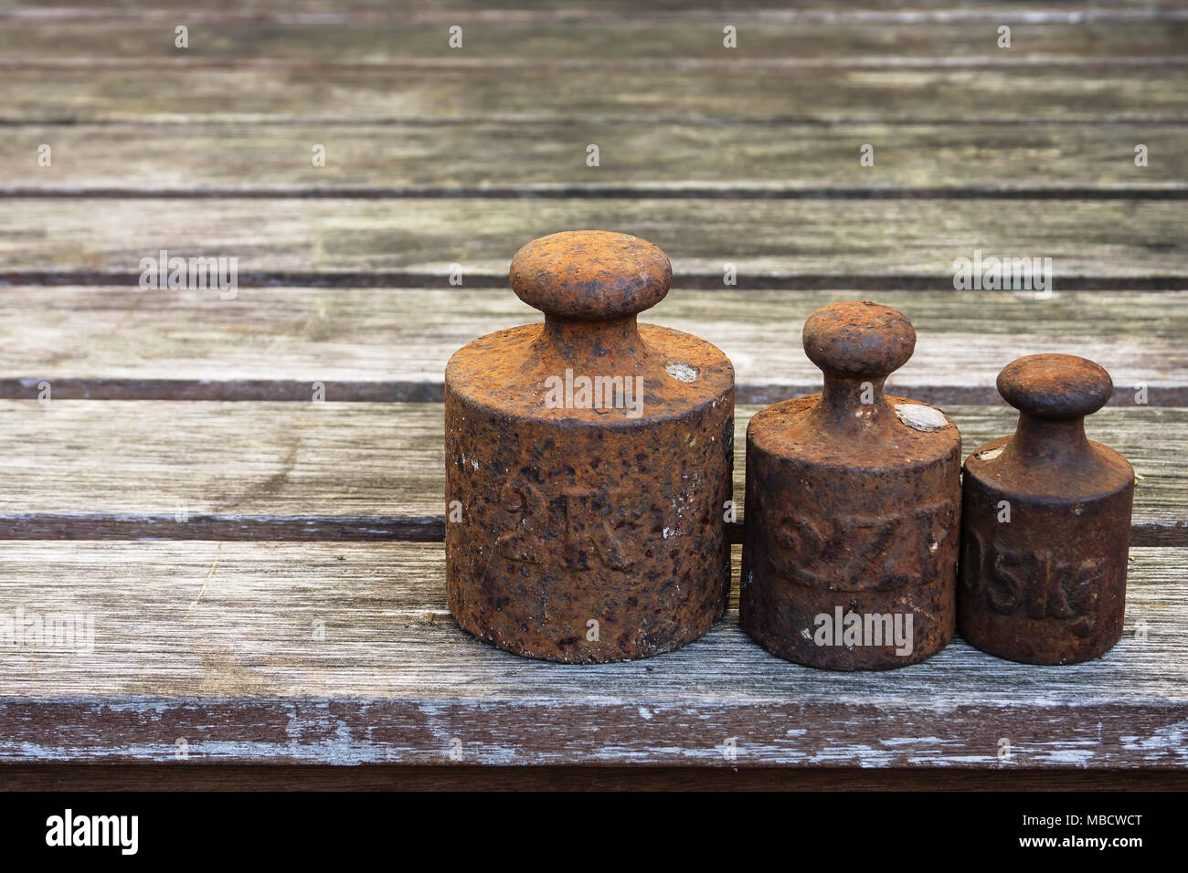 old weight tools. Rusty instruments for accurate measurements - Stock Image