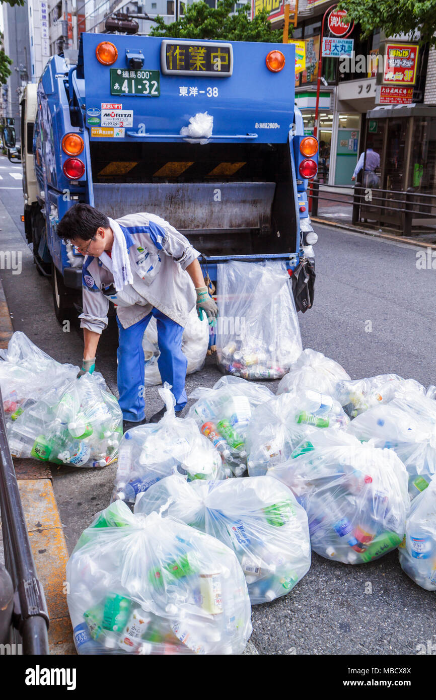 Tokyo Japan Ikebukuro garbage collection collector Asian man truck
