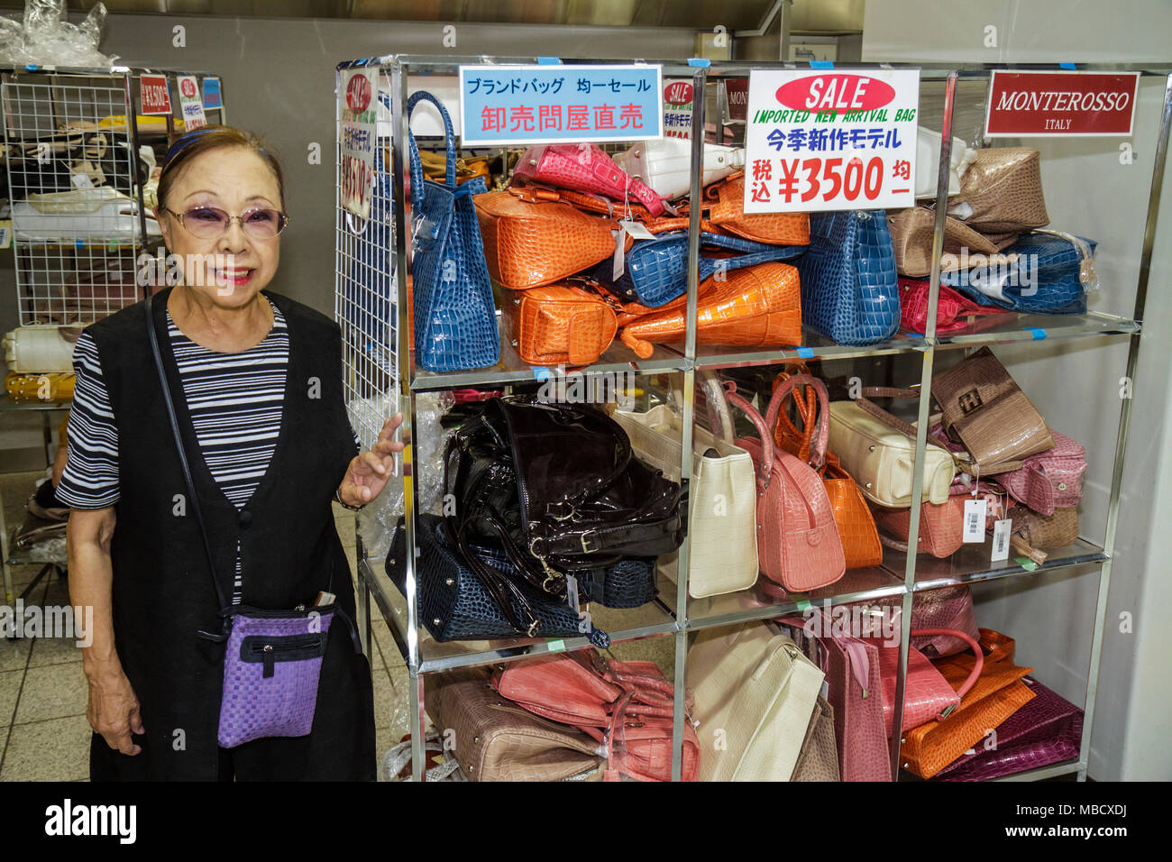 Tokyo Japan Shinjuku Shinjuku Station women's handbags purses for sale imported Italian fashion Asian woman shopping sales clerk Stock Photo