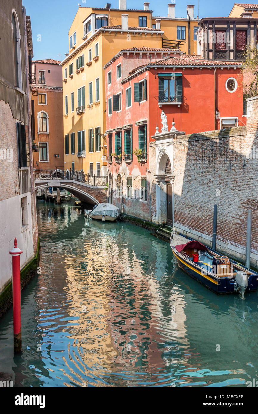 Colorful canal in Venice Italy - Stock Image