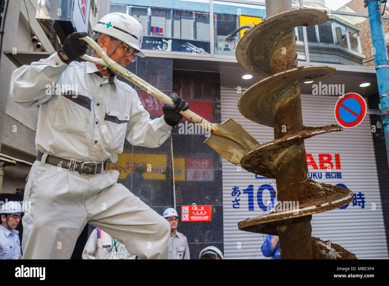 Tokyo Japan Shinjuku Asian man utility construction worker drill shovel hard hat uniform job - Stock Image
