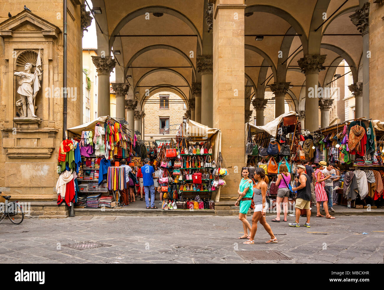 Florence, Italy, June 2015: tourists and Florentines walking and shopping in the historic Mercato del Porcellino (pig market) in the center of Florenc - Stock Image
