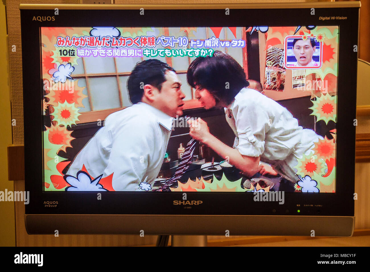 Tokyo Japan Ikebukuro Sharp Aquos widescreen LCD HDTV TV television kanji hiragana katakana characters symbols comedy show Asian - Stock Image