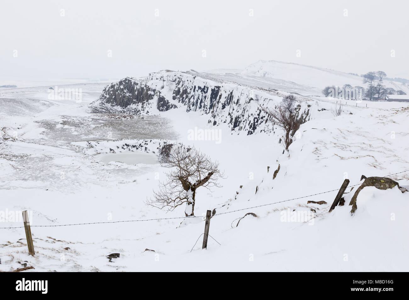 Hadrian's Wall - the remains of Greenhead Quarry, a little east of Walltown Quarry, under a thick coating of snow - Stock Image