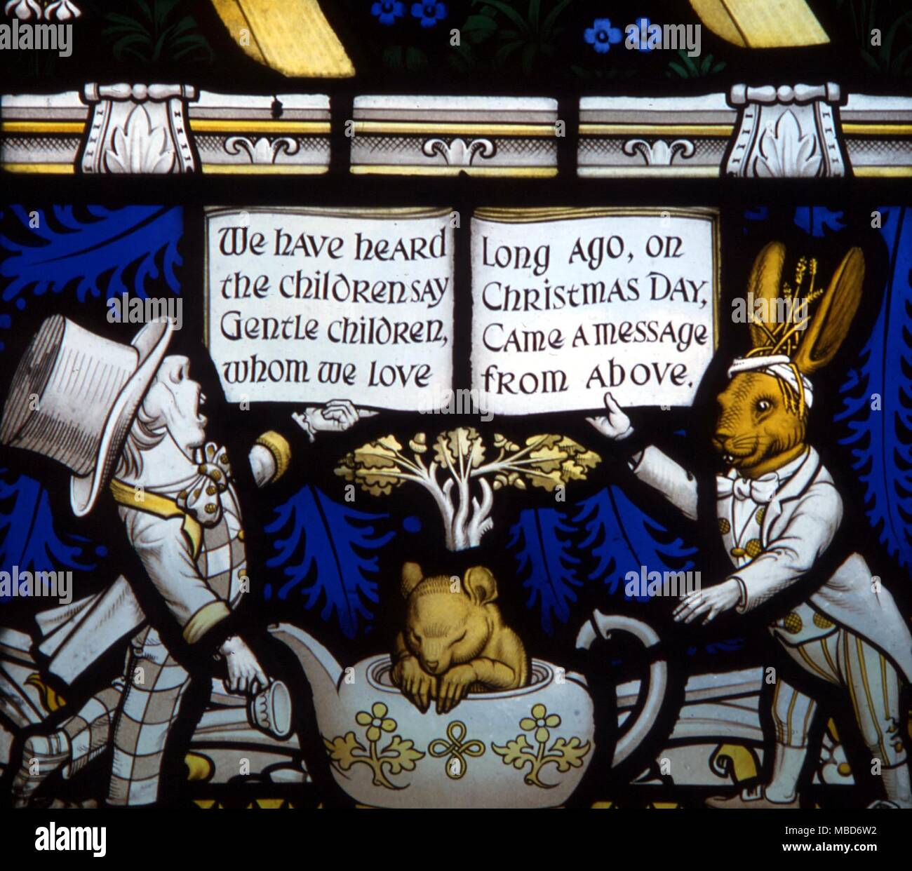 Myths - Daresbury - The Lewis Carroll memorial window at Daresbury Parish Church was designed by Geoffrey Webb, and dedicated in 1934.  The Mad Hatter, the Dormouse and the March Hare. - We have heard the children say, Gentle children whom we love, Long ago, on Christmas Day, Came a message from above. - Stock Image