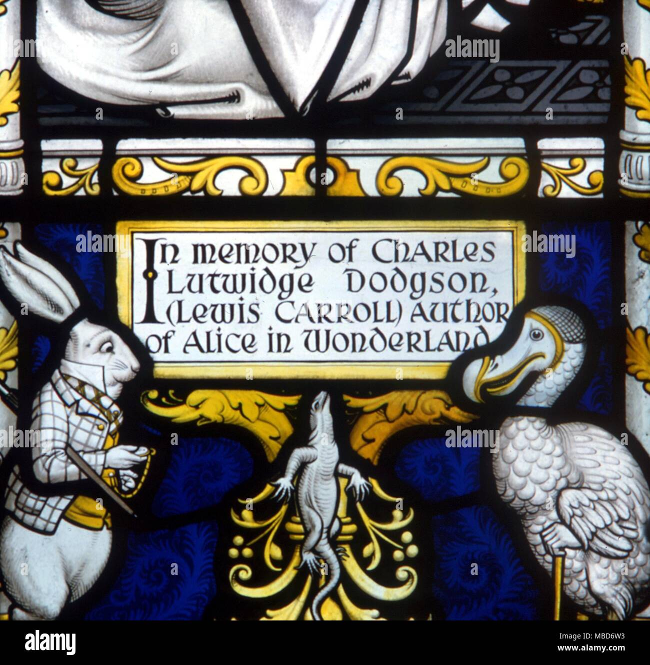 Alice in Wonderland - The White Rabbit, the Dodo and the Lizard.  Detail from the Lewis Carroll memorial window at Daresbury. - In memory of Charles Lutwidge Dodgson - Stock Image