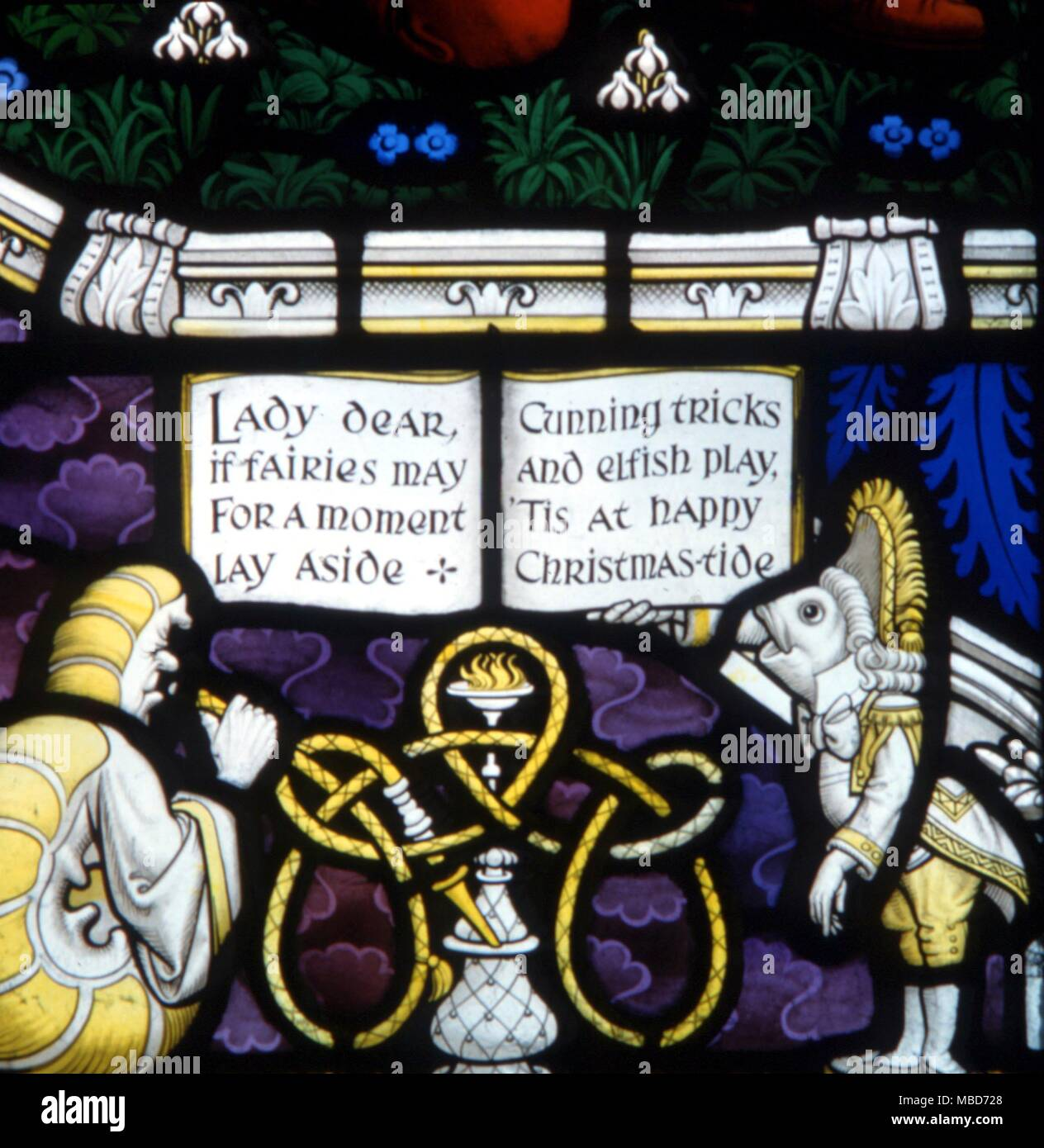 Myths - Daresbury - The Lewis Carroll memorial window at Daresbury Parish Church was designed by Geoffrey Webb, and dedicated in 1934.  Caterpillar smoking his pipe - Lady dear if fairies may for a moment lay aside cunning tricks and elfish play 'tis at happy Christmas-tide - Stock Image