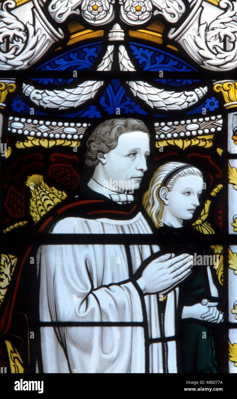 Fairy stories - Lewis Carroll - The author Carrol with the young Alice - detail from the stained glass window dedicated to Lewis Carroll in which his fairytale characters appear.  Daresbury parish church. - Stock Image