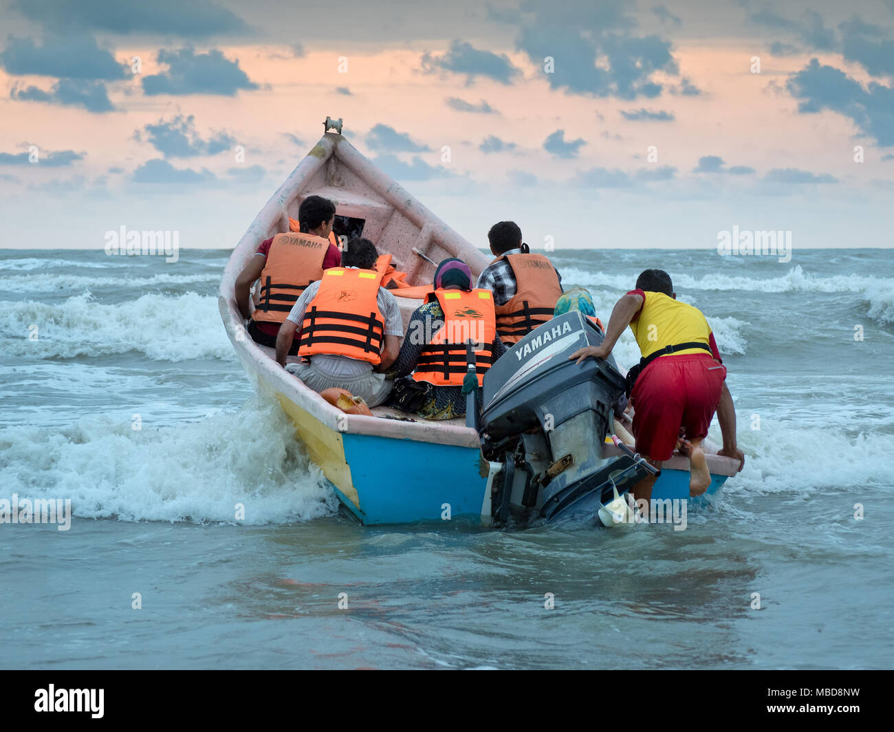 Babolsar, Iran - July 24, 2016 : Iranian tourists going for ride on a motorboat on the Caspian sea - Stock Image