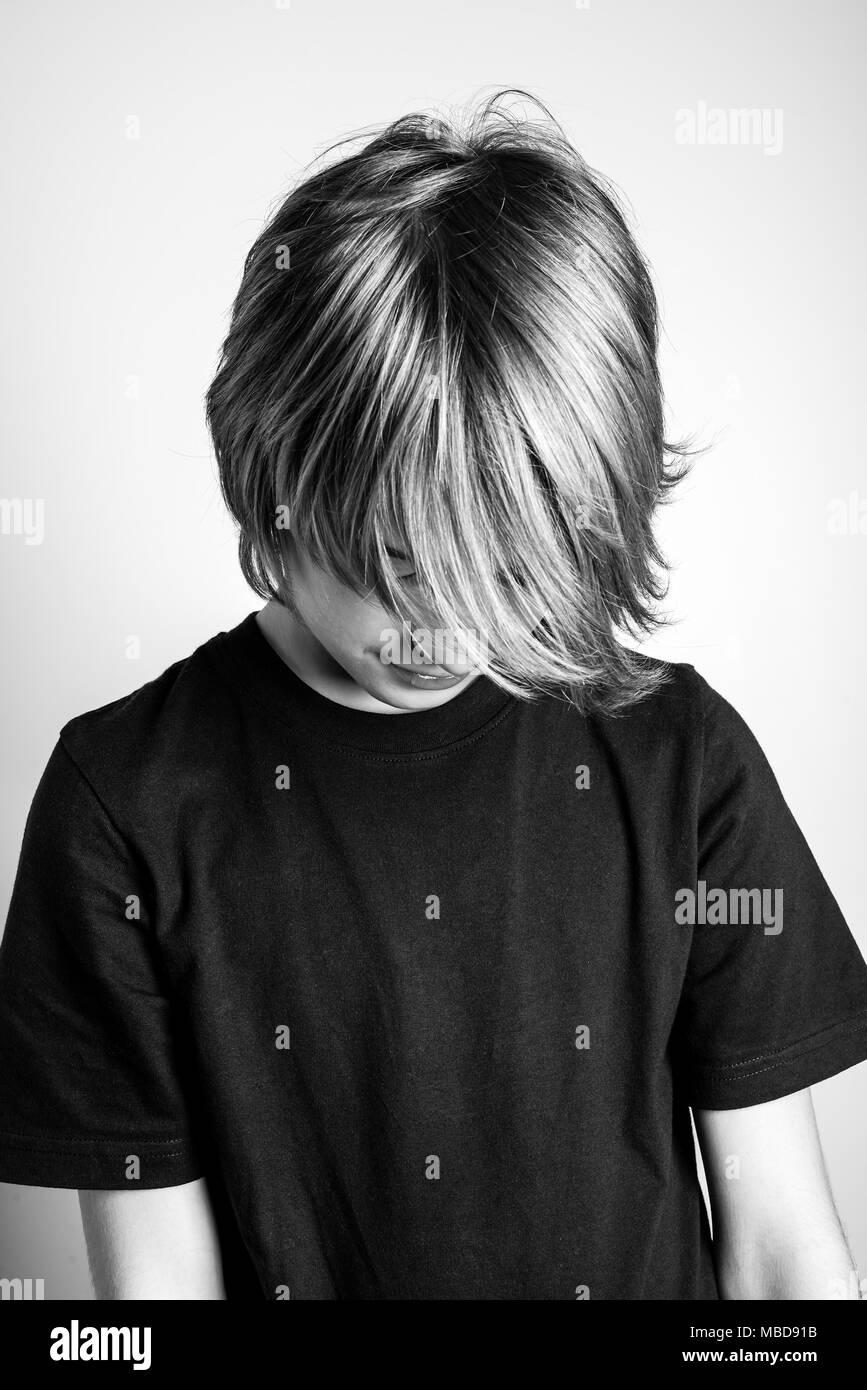 shame - black and white photo - Stock Image