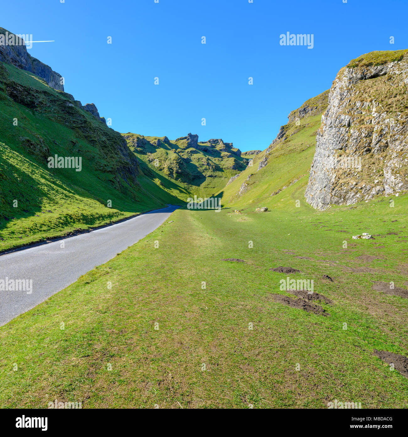 Winnats Pass, near Castleton, on a sunny clear blue sky day without people or cars, Peak District, Derbyshire, UK - Stock Image