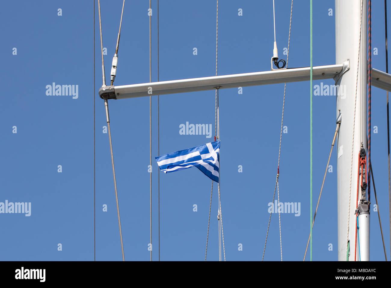 Greek flag on yacht on a shroud under spreader. White and blue ...