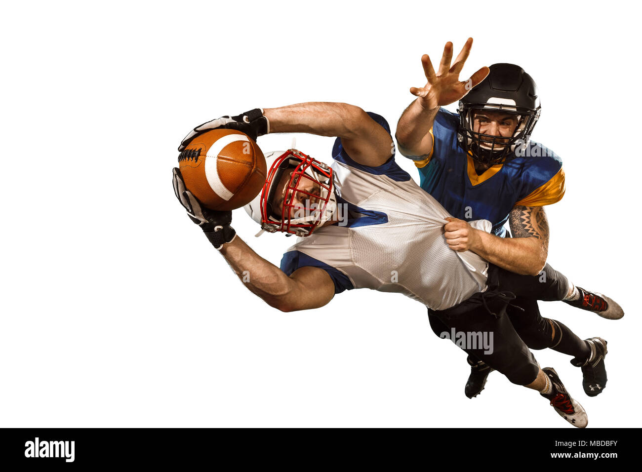 The two american football players studio isolated on white background Stock Photo
