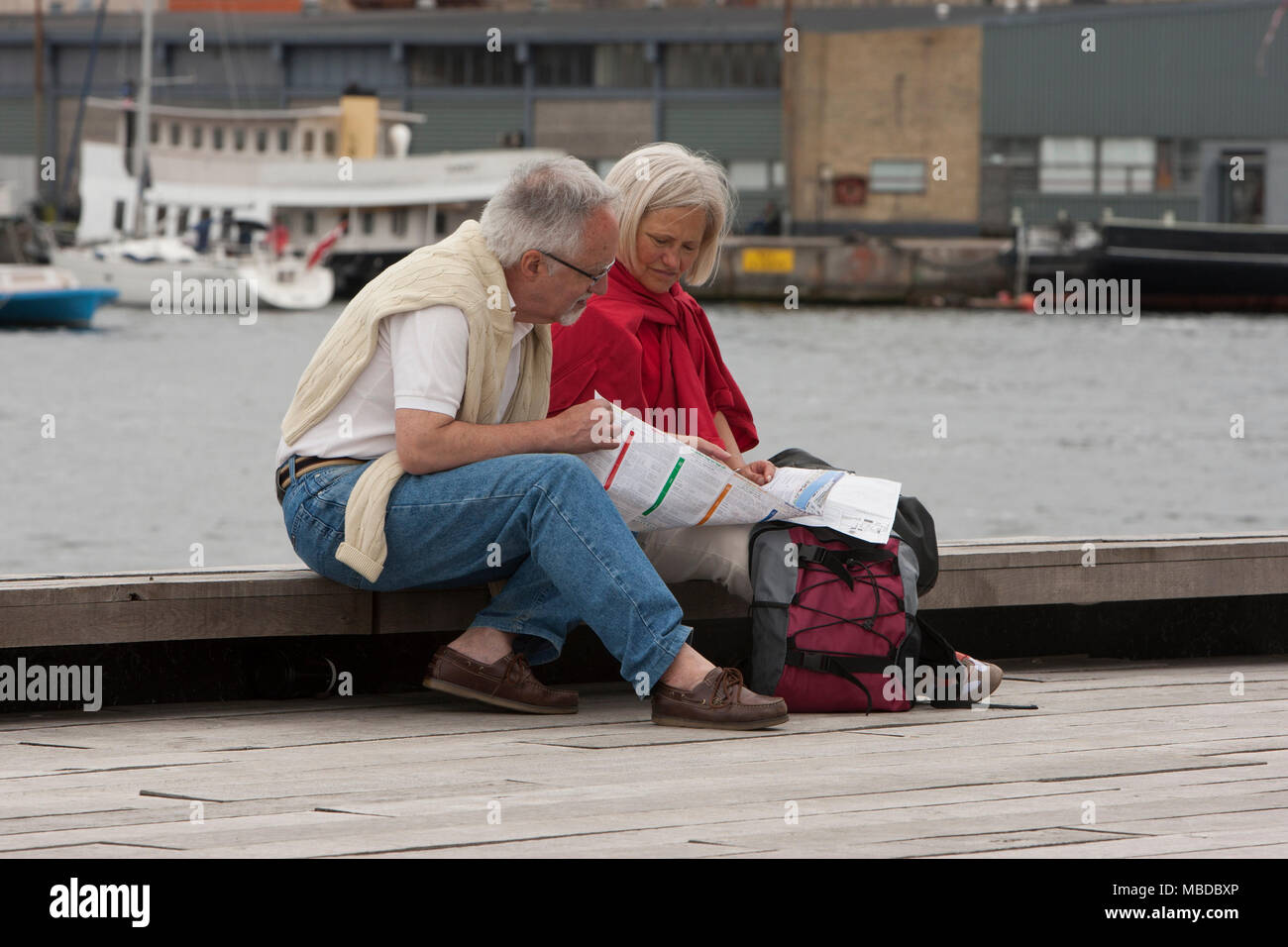 A touristing older couple looking at the map, Copenhagen, Denmark. - Stock Image