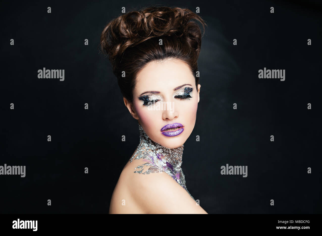 9a7a6caf34a Pretty Woman Fashion Model with False Eyelashes and Glitter Eyeshadow.  Creative Makeup - Stock Image