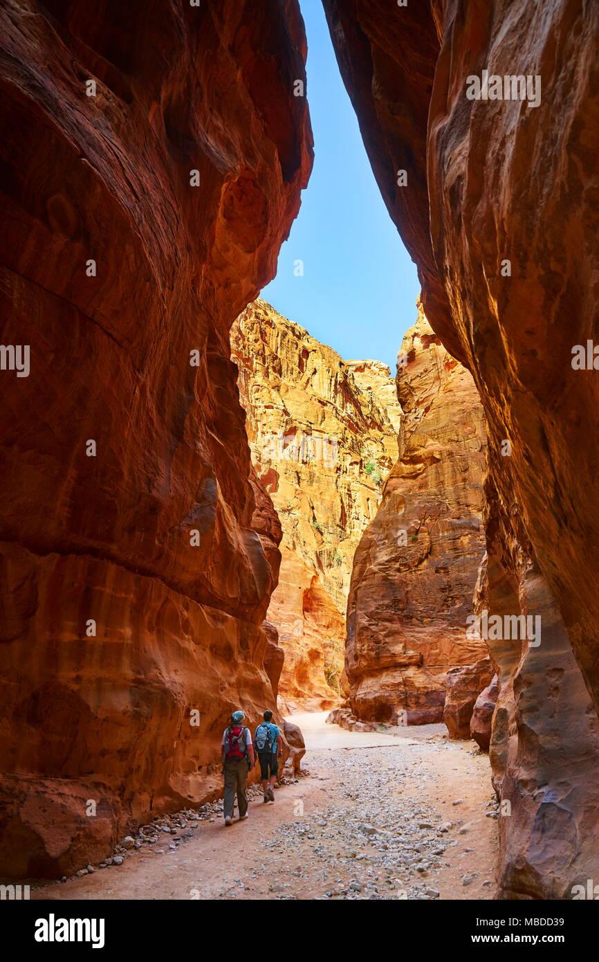 The Siq - narrow gorge canyon leads into the ancient city of Petra, Jordan Stock Photo