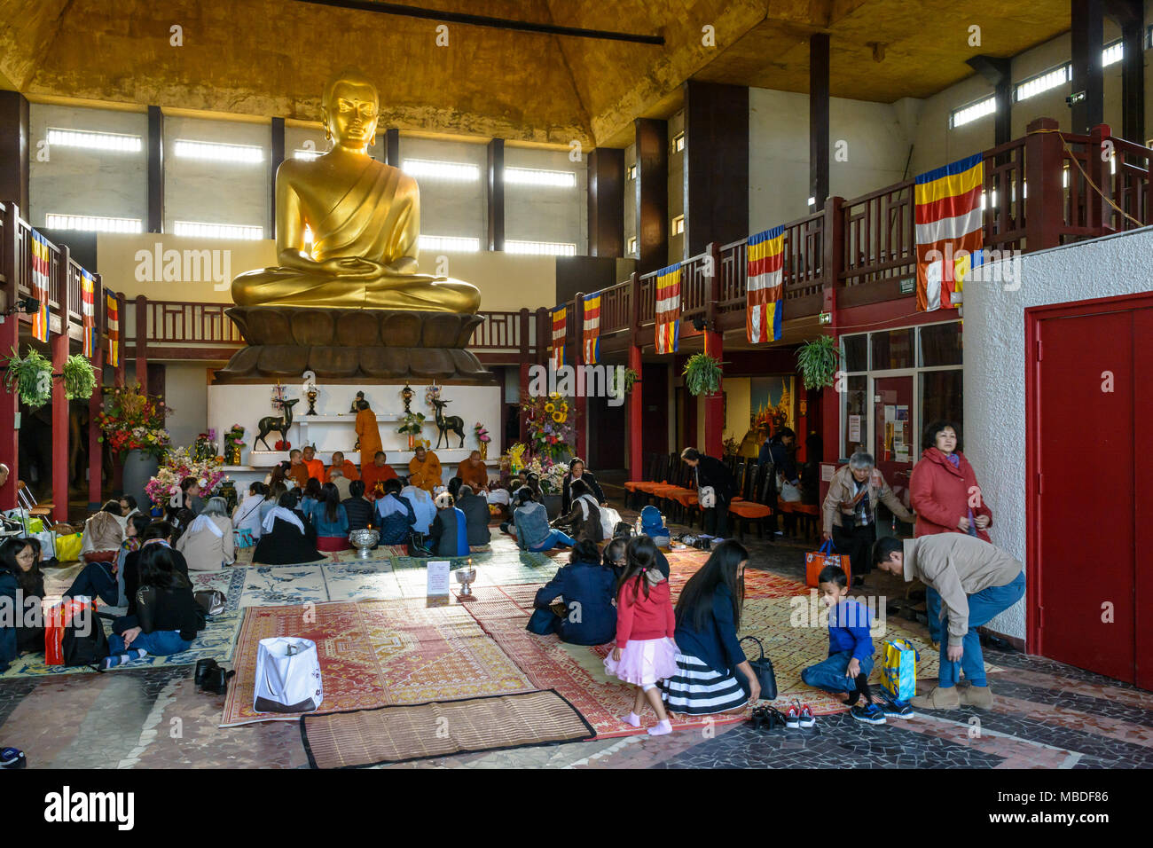 Upon the Khmer New Year celebration, people from the southeast asian community attend the ceremony and pray Buddha in the Great Pagoda of Vincennes. Stock Photo