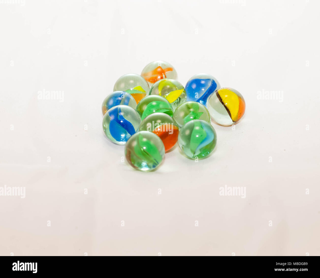 Misc various colors of cats-eye marbles from the collection - Stock Image