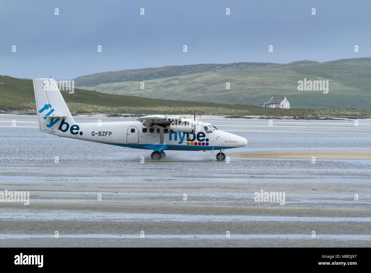 DHC Twin Otter passenger aeroplane taxying prior to take off from Barra Airport, Isle of Barra, Outer Hebrides, Scotland - Stock Image