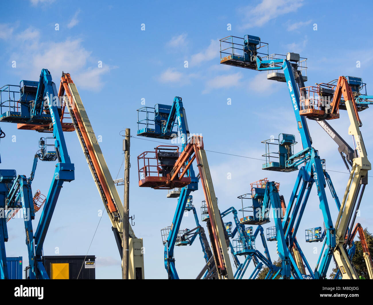 """Aerial work platforms or """"cherrypickers"""". The term """"Cherrypicking"""" has been widely used in the UK/EU Brexit negotiations Stock Photo"""