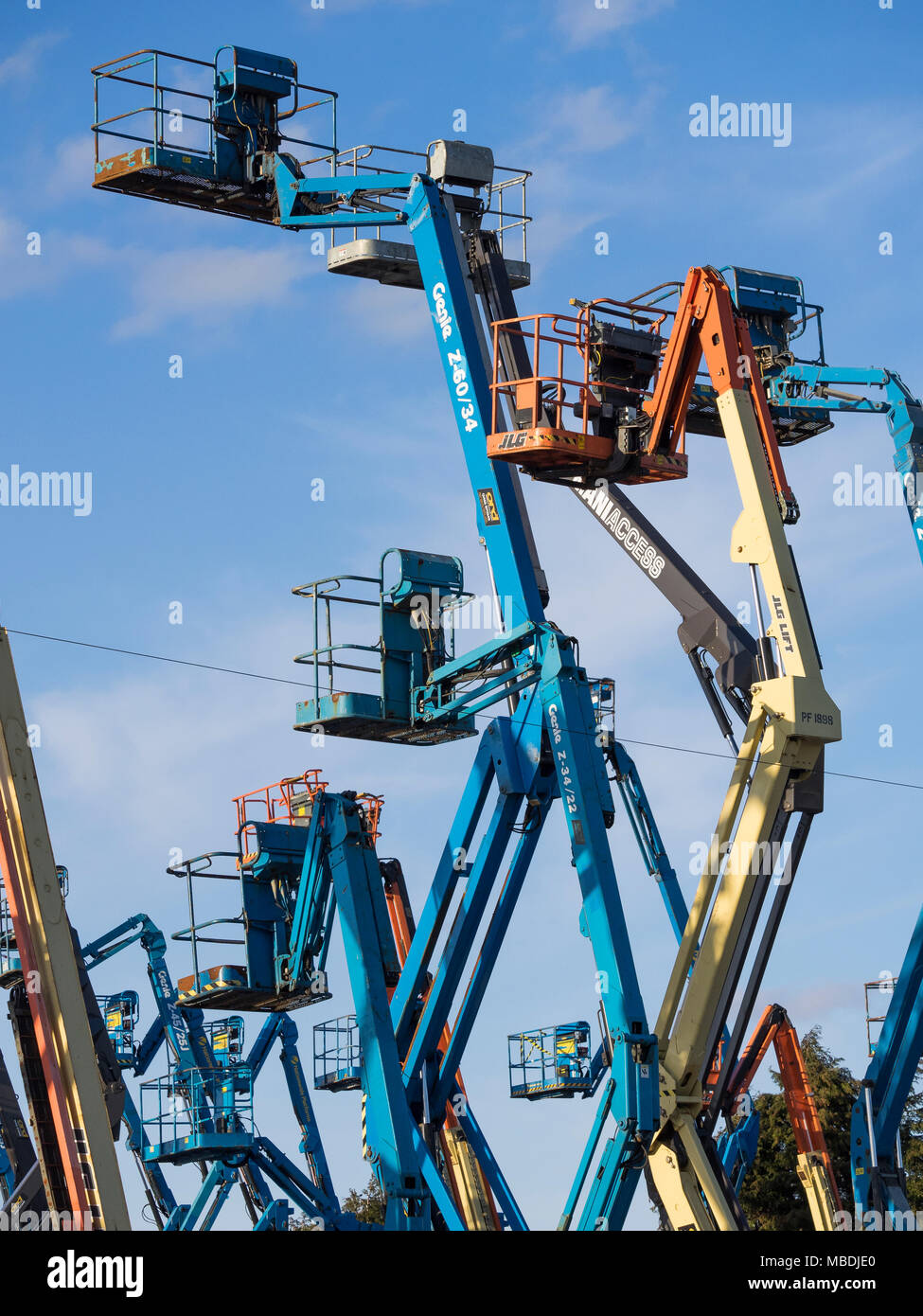 Aerial work platforms or 'cherrypickers'. The term 'Cherrypicking' has been widely used in the UK/EU Brexit negotiations - Stock Image