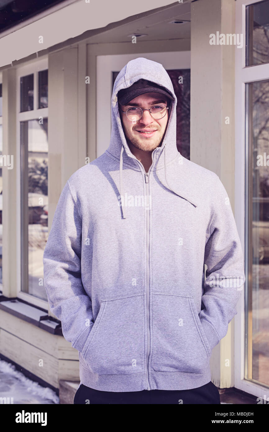526cc6d2 Sporty young man with hoodie and glasses Stock Photo: 179164793 - Alamy