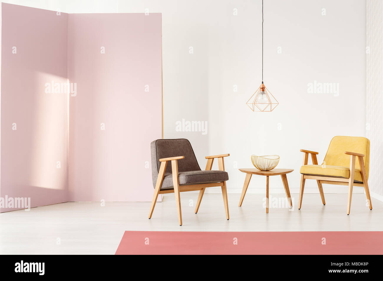 Feminine living room interior with pastel wall, vintage armchairs ...
