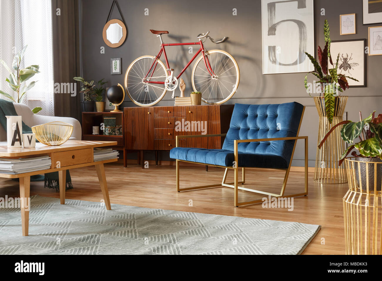 Blue And Golden Armchair Wooden Table Retro Cabinet With A Bike On Top In