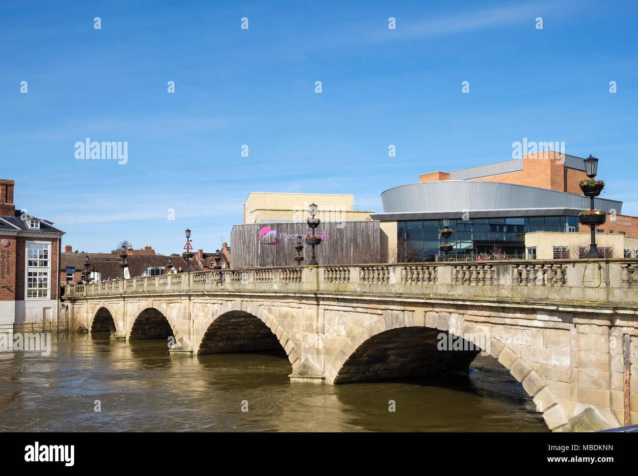 The Welsh Bridge over the River Severn with high water level and TheatreSevern beyond. Shrewsbury, Shropshire, West Midlands, England, UK, Britain - Stock Image