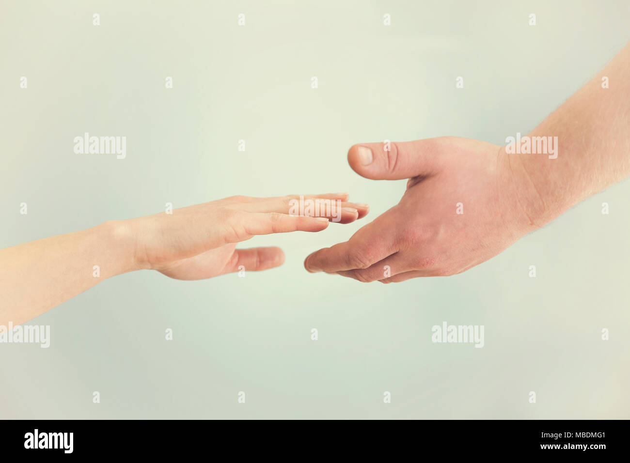Support concept. Two hands reaching toward each other. Empathy, compassion, help, kindness - Stock Image