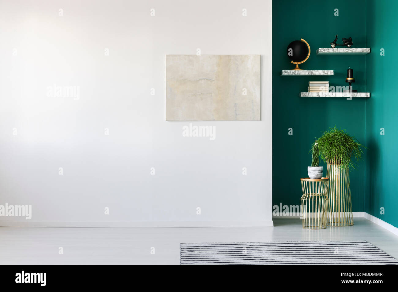 Bright painting on white wall and plants against green wall in ...