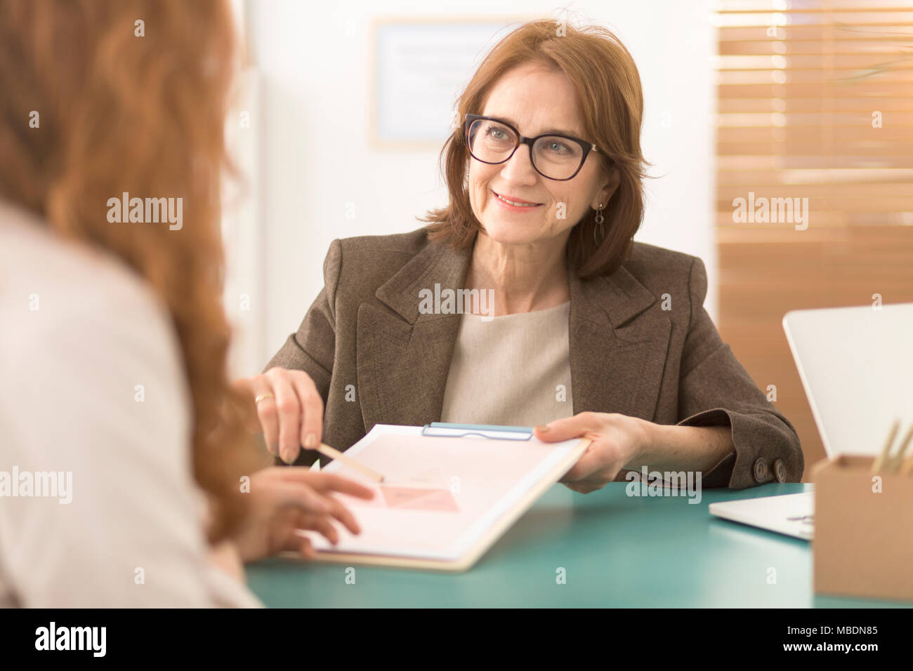 Professional advisor working with burnt out corporate employee Stock Photo