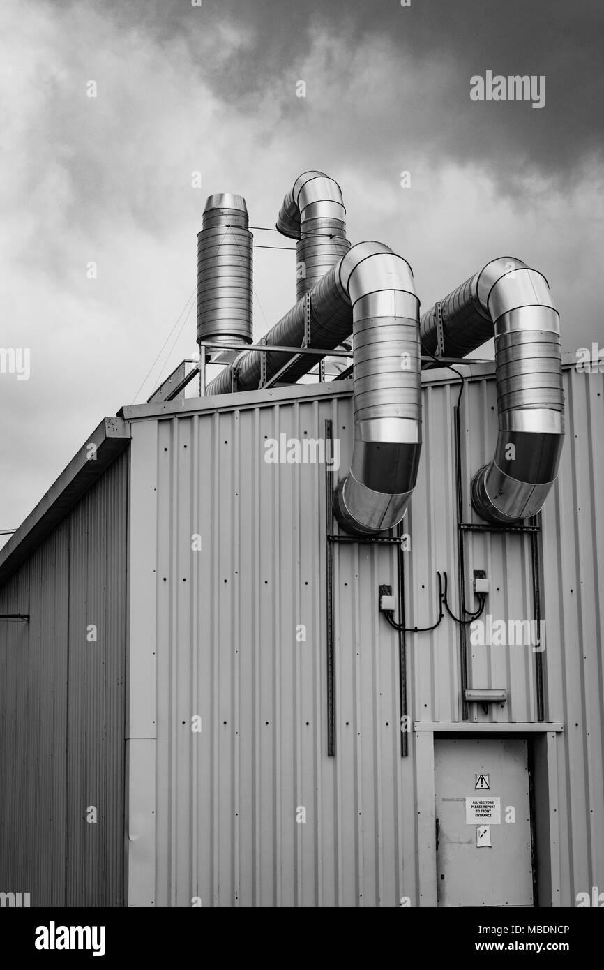 Black and white image of Industrial / manufacturing plant exhaust system. Metaphor UK light industry. Stock Photo