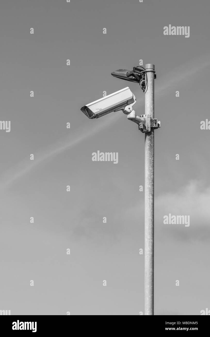 Black and white monochrome of CCTV security camera - Watching over You, surveillance / Orwellian / Big Brother / intelligence gathering concepts. Stock Photo