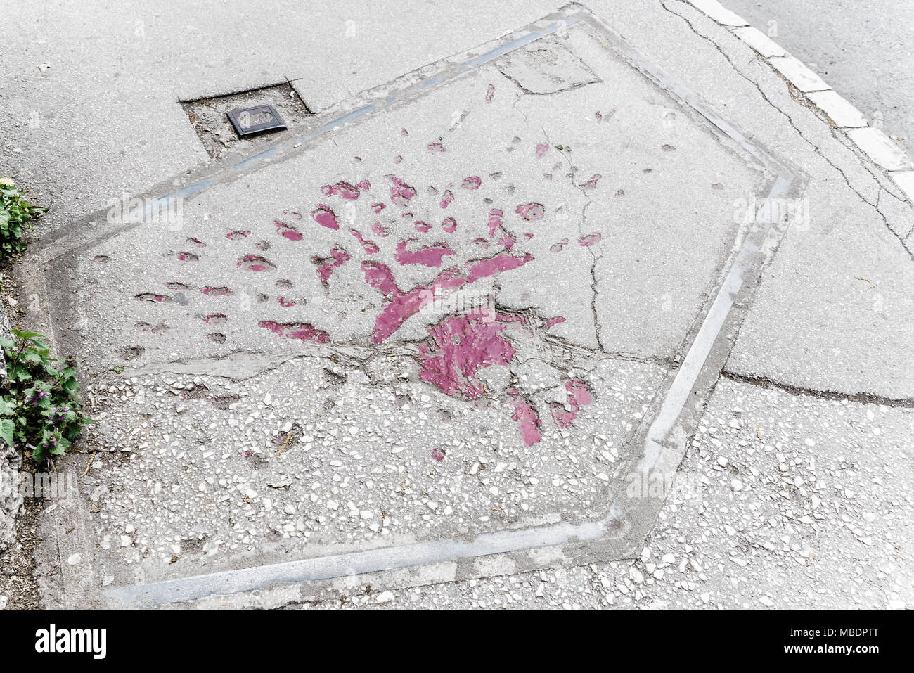 Markings on the streets of Sarajevo indicating where mortar shells exploded during Bosnian war in 1990s Stock Photo