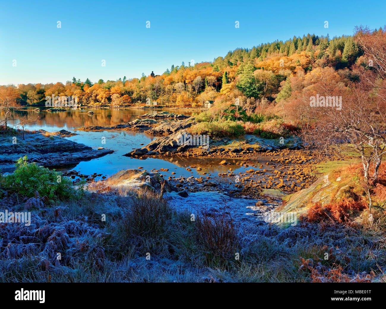 A sunny, autumn view of Loch Sunart in the Scottish Highlands as the first signs of winter appear. - Stock Image