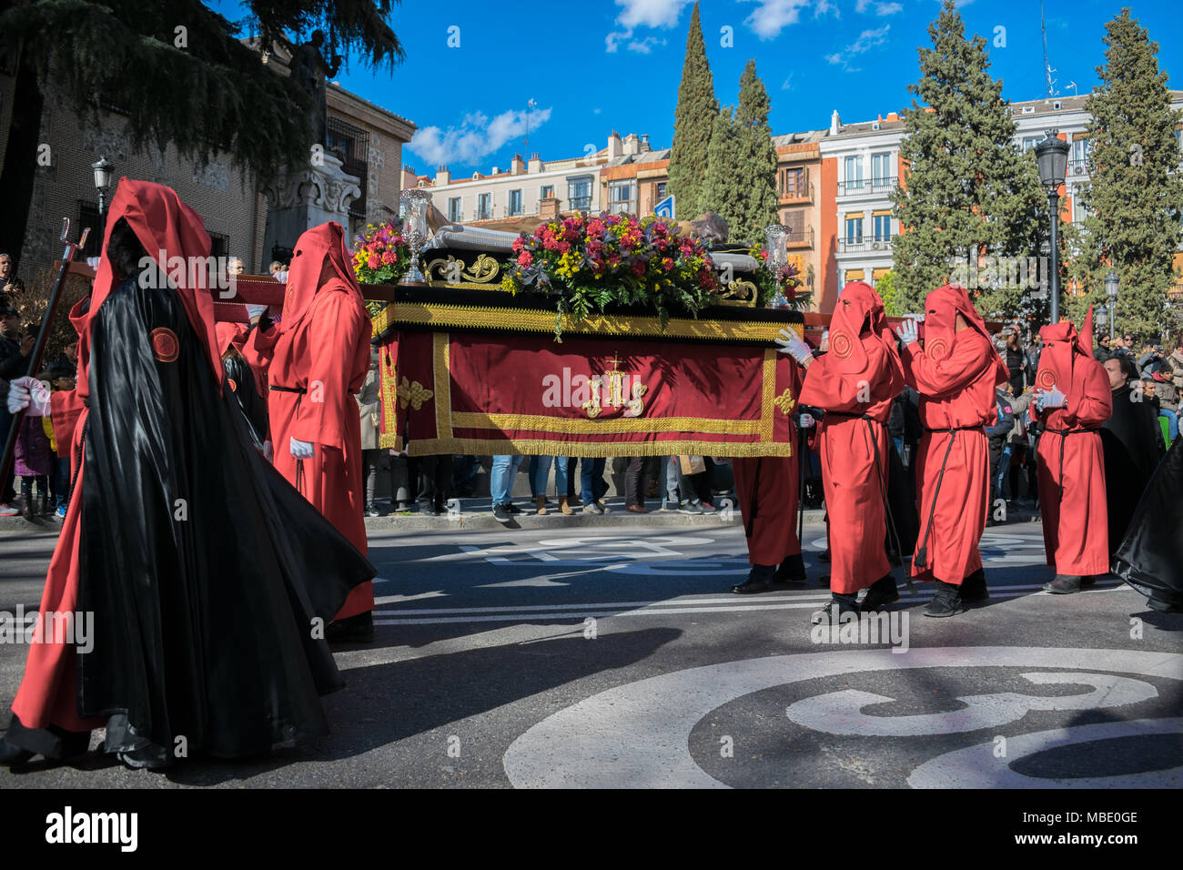Penitents carry an effigy of Jesus during an Easter parade on Holy Saturday, Semana Santa (Holy Week) parades, Madrid, Spain, 2018 - Stock Image