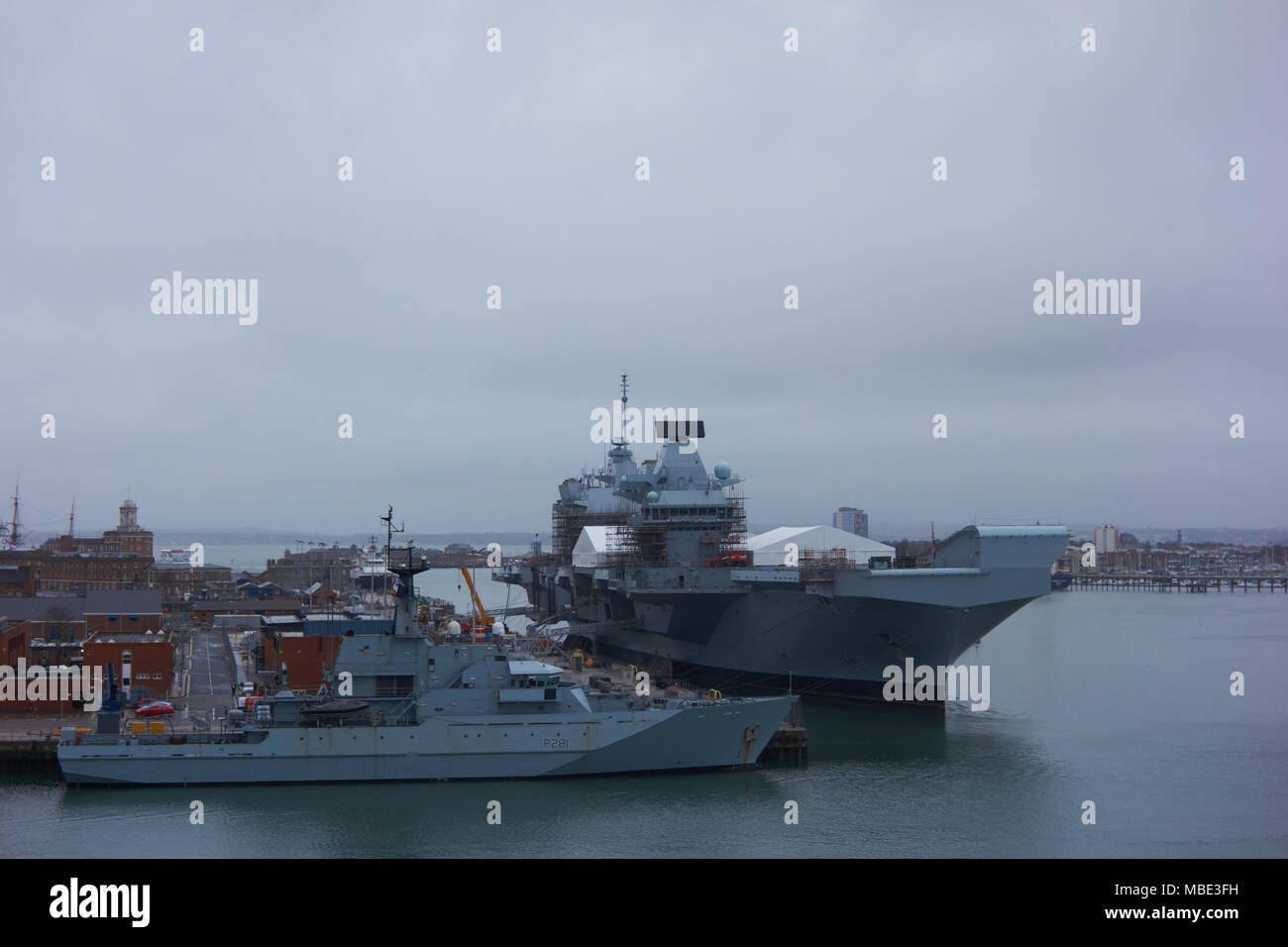 Starboard bow view of Royal Navy HMS Queen Elizabeth under maintenance in Portsmouth, UK - Stock Image