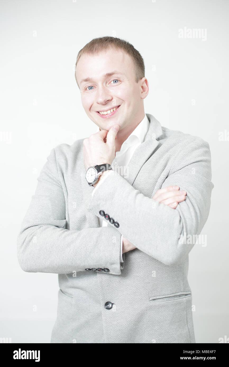 Portrait of smiling man on white background - Stock Image