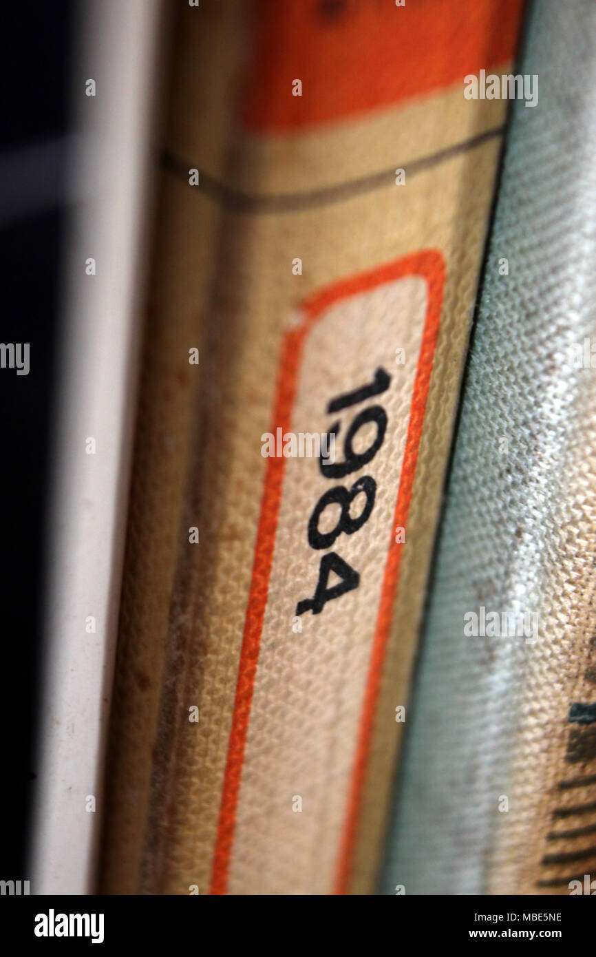 1984 George Orwell title printed in book spine, close-up - Stock Image