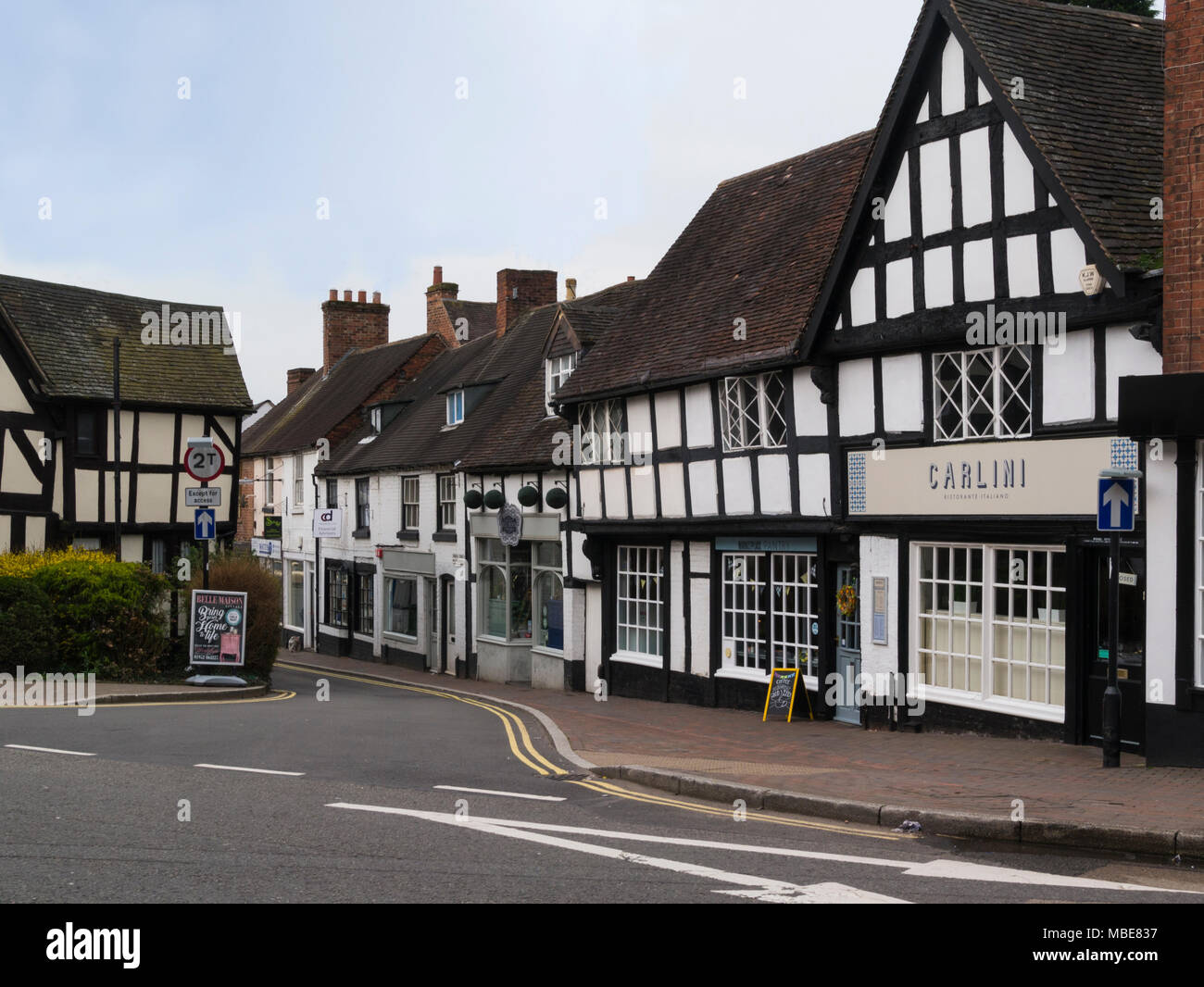 Medieval properties containing independent businesses in Church Street small historic market town Shifnal Shropshire England UK - Stock Image