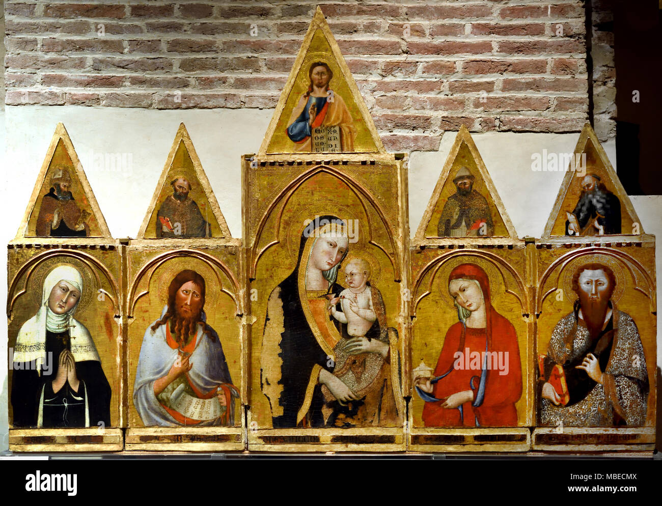 Madonna and Child with Saints Bona, John the Baptist, Mary Magdalene, and Bartholomew, In the cusps God father among the Saints Doctors and Antonio Abate by Giovanni di Nicola 14th Century Pisa.  Italy Italian - Stock Image