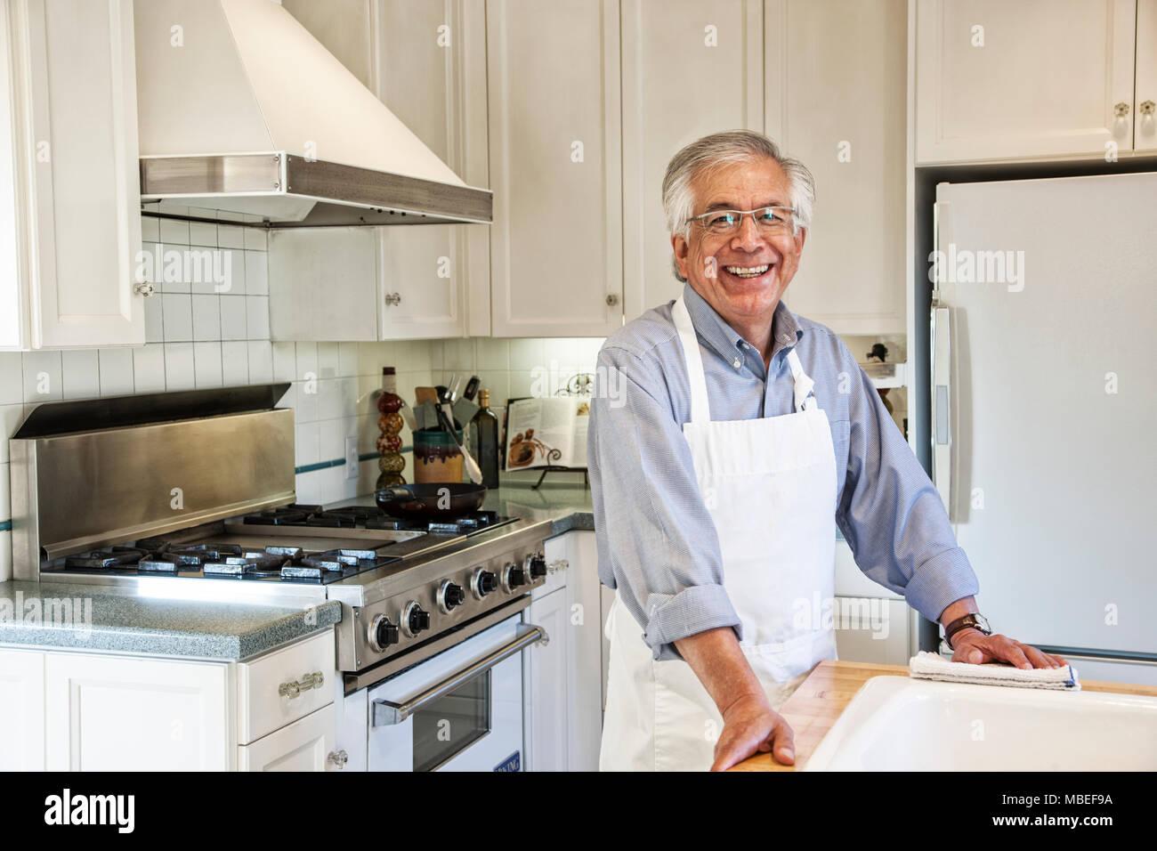 HIspanic senior man in his remodeled kitchen - Stock Image
