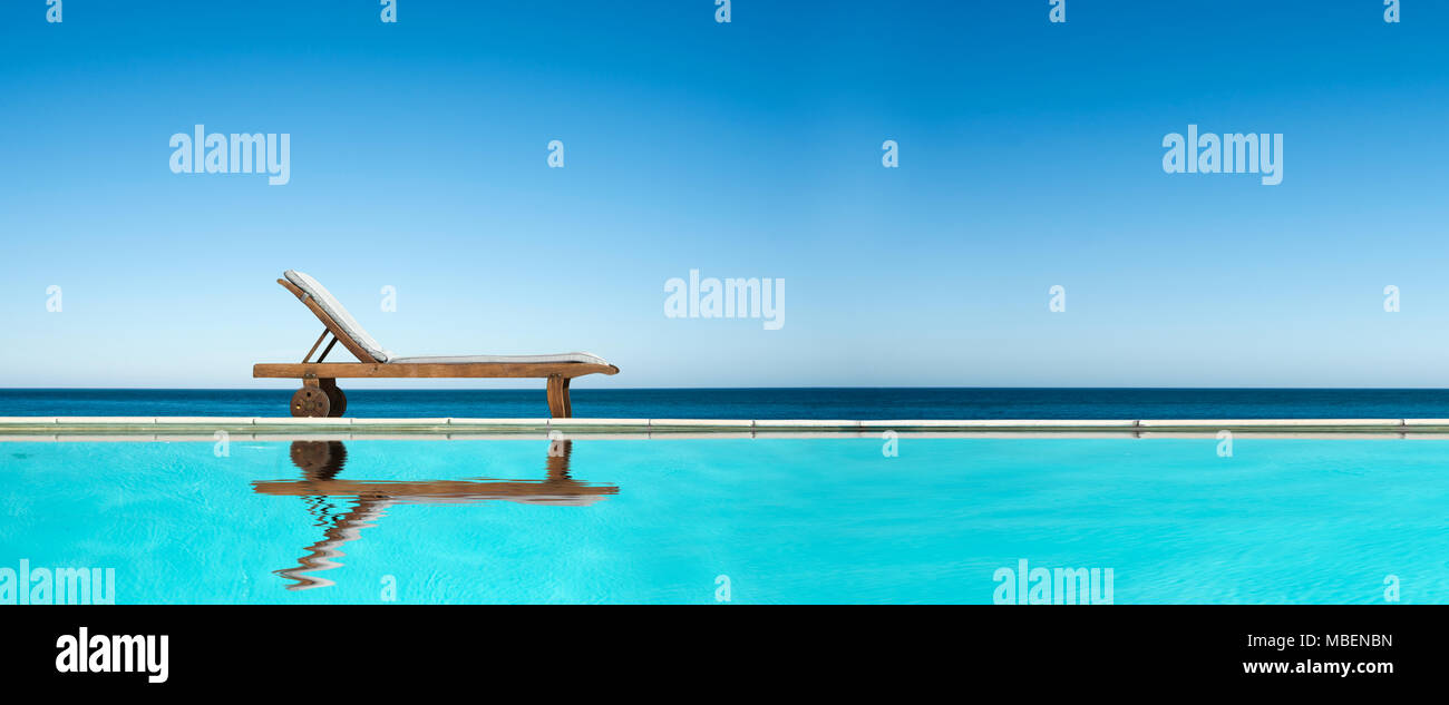 Reclining chair near a swimming pool sea and blue sky panoramic reclining chair near a swimming pool sea and blue sky panoramic background voltagebd Images