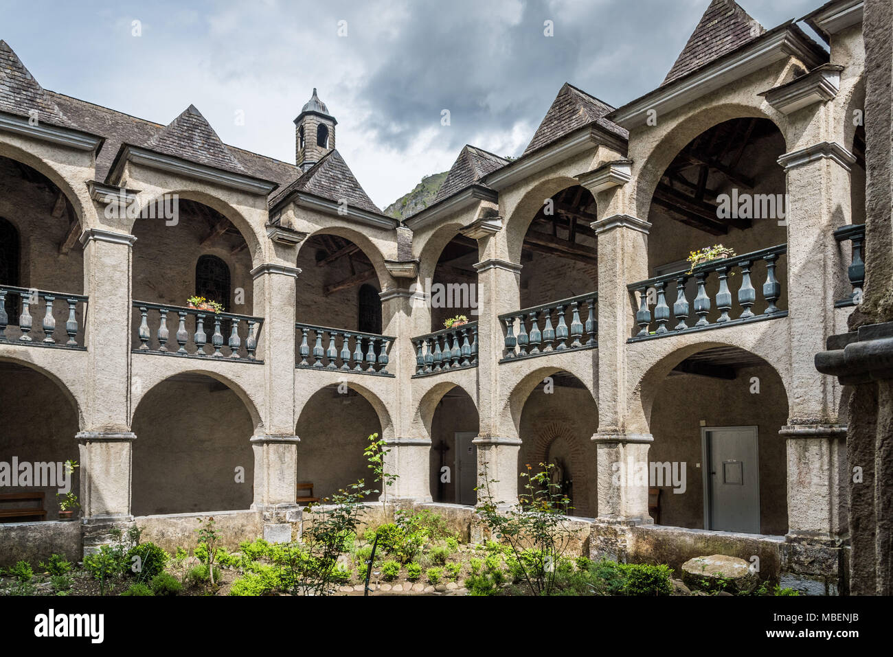 Sarrance (south western France): cloister of the Monastery of Sarrance, stage on St James Way (the pilgrimage route to Santiago de Compostela), on the - Stock Image