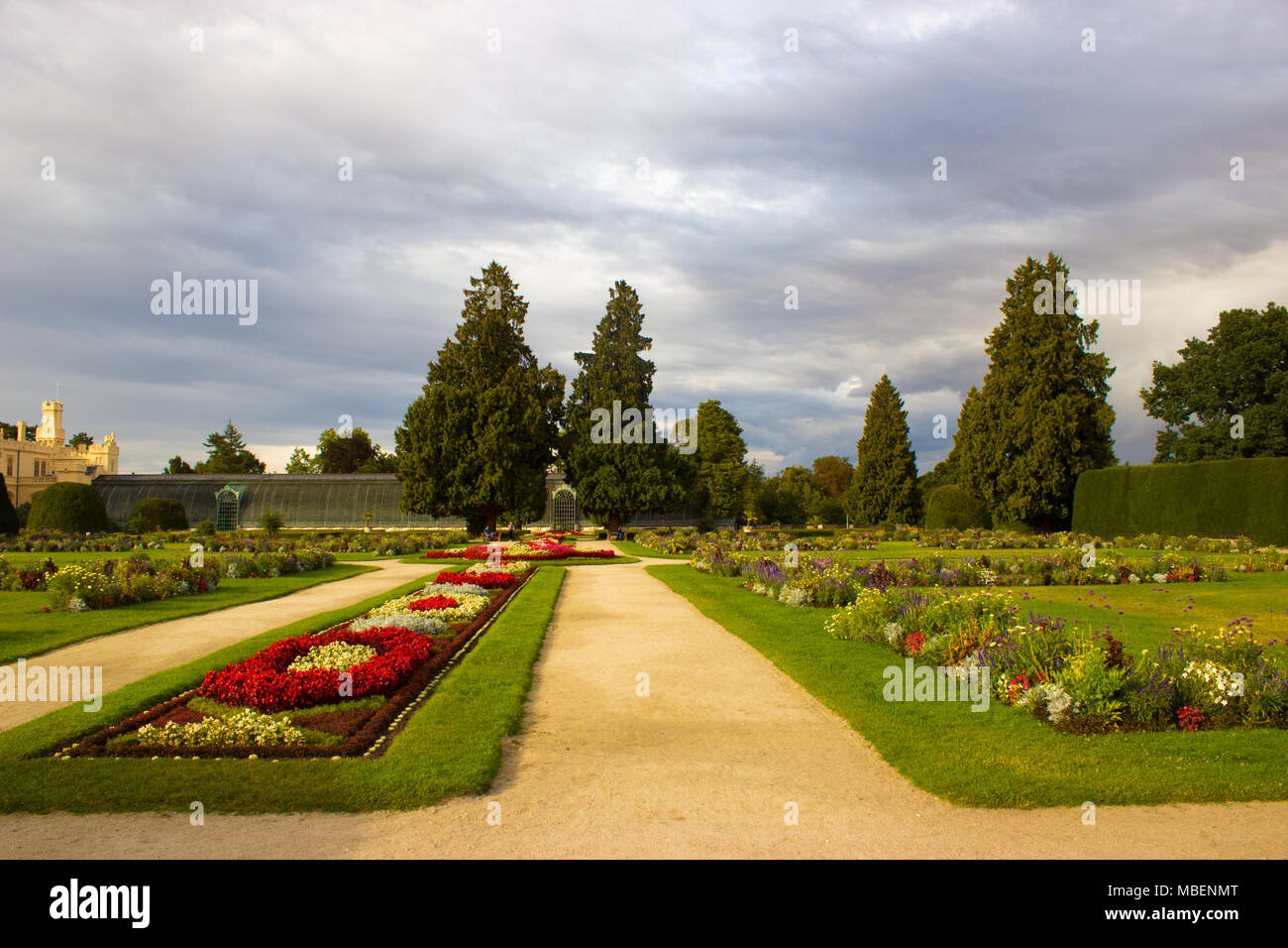 Chateau park Lednice with flowers and trees. On the left is Lednice castle. Stock Photo