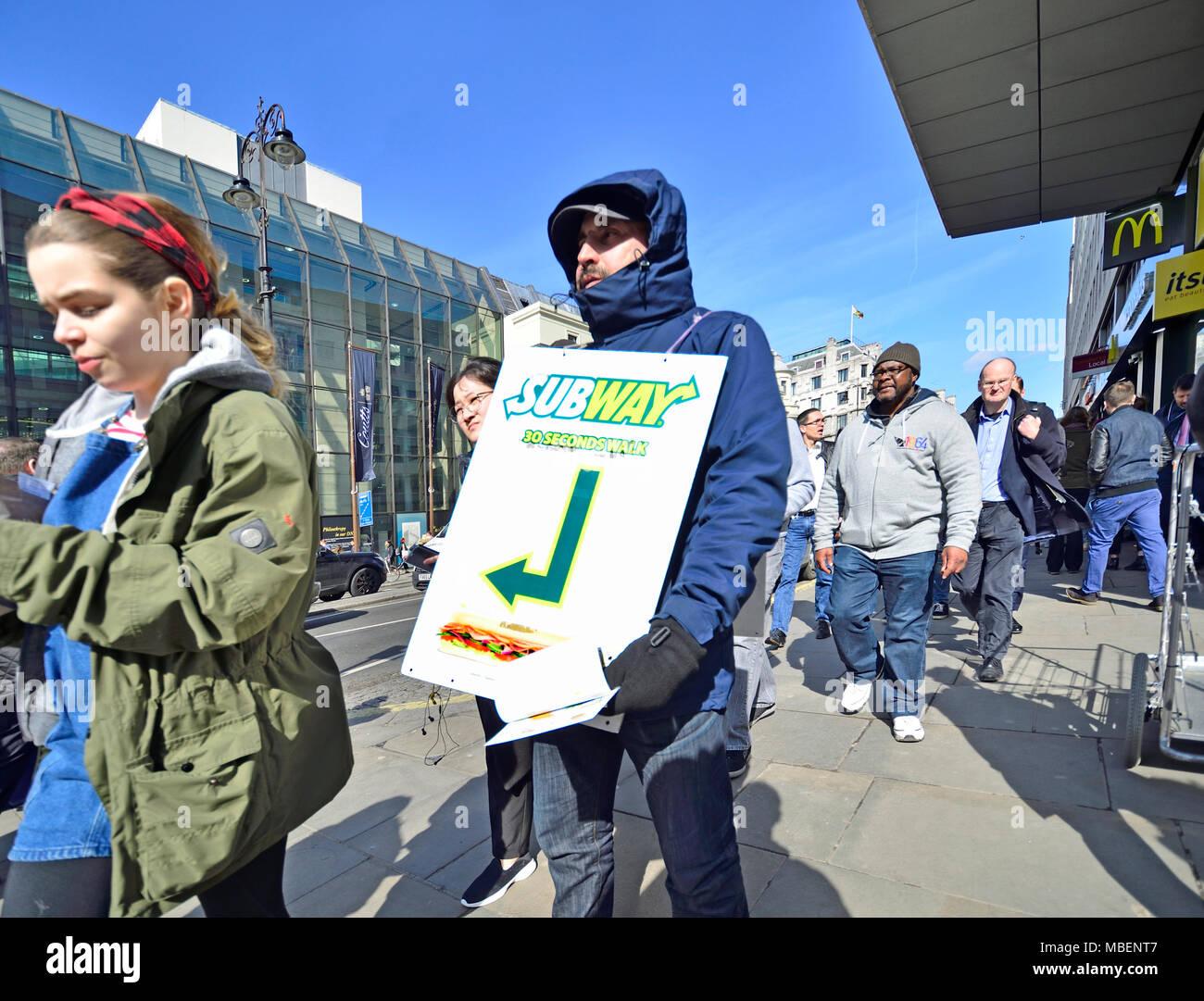 London, England, UK. Man ijn Oxford Street holding advertising for Subway sandwich shop - Stock Image