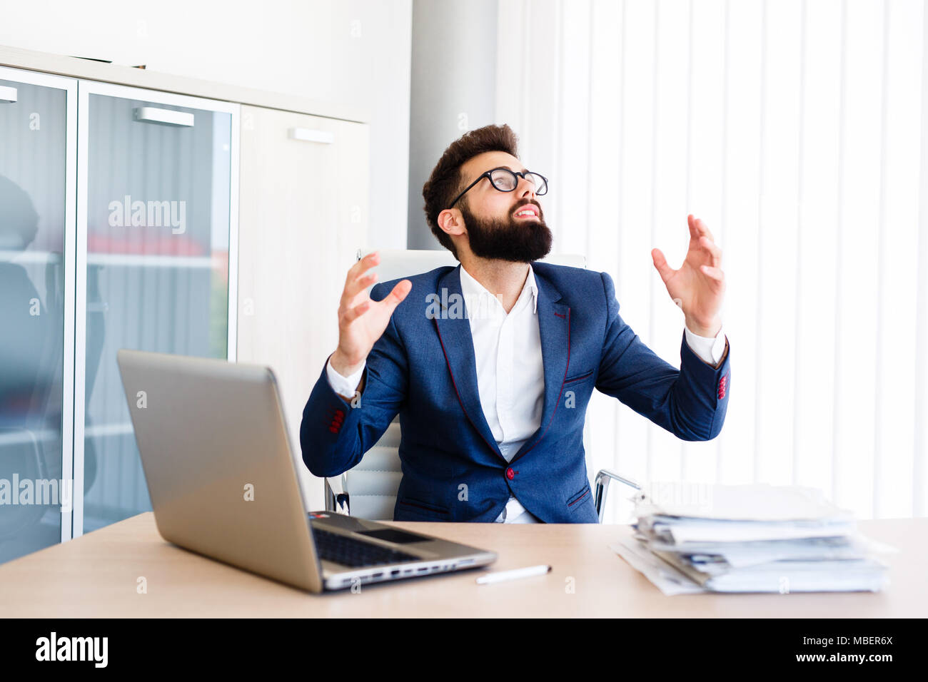 Young Businessman Has Very Stressful Day At Work Stock Photo