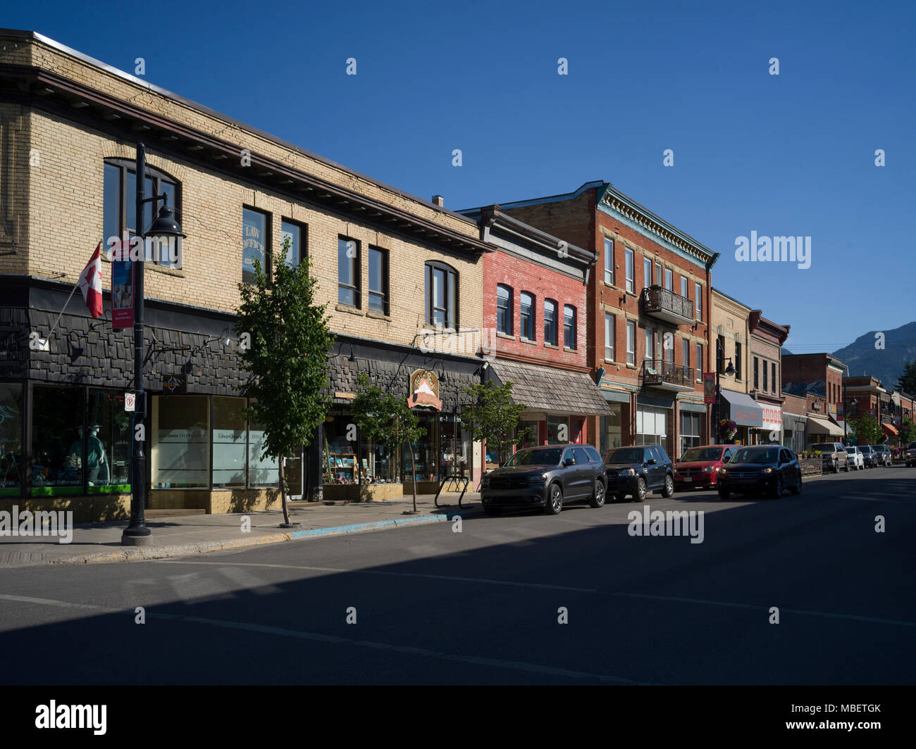Cars parked at roadside, Fernie, British Columbia, Canada - Stock Image
